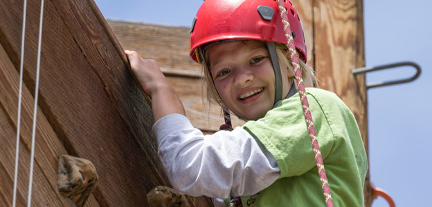 Girl Scout on climbing wall
